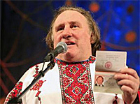 Gérard Depardieu  dressed in Russian embroidered shirt is showing off his Russian passport