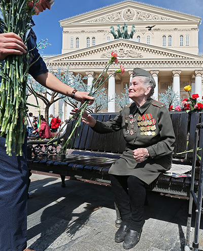 From The Guardian: A medalled Russian WWII woman veteran accepts flowers