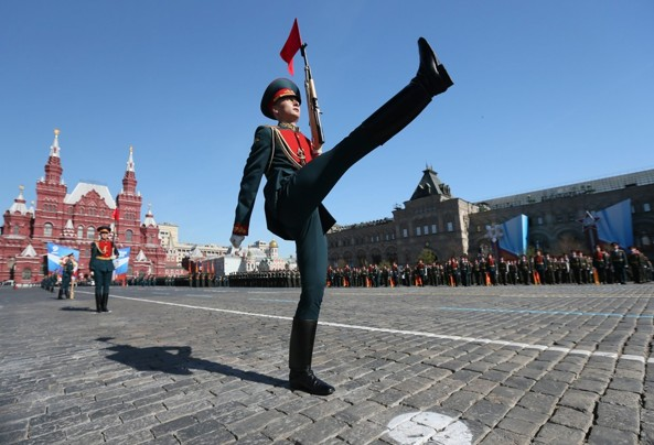 SERGEI ILNITSKY/EPA.  A high kicking Russian military serviceman leads his regiment as they march during Victory Day parade in Moscow  on May 9  2013