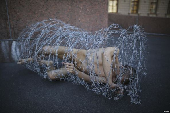 He was also arrested after wrapping his naked body in barbed wire outside a Saint Petersburg government building in May.