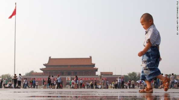 A boy plays in Tiananmen Square in Beijing on June 3, 2012.