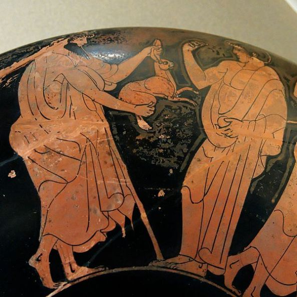 Detail of the exterior of an Attic red-figure kylix, ca. 480 BC. From Vulci. Заяц A bearded man gives a hare, a popular erotic gift, to a boy
