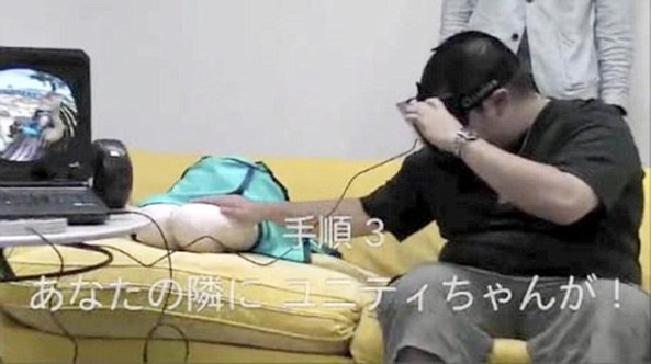 A bizarre pillow shaped like a pair of girls legs coupled with a virtual reality headset is offering hope to men who do not want to spend the evenings alone sitting on the sofa - in the form of a pair of legs that users interact with in virtual reality. Pictured is a man testing the virtual girlfriend developed by a Japanese firm.