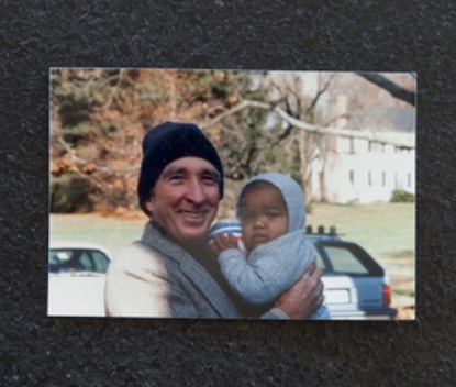 Photo of John Updike with one of seven of his grandchildren.