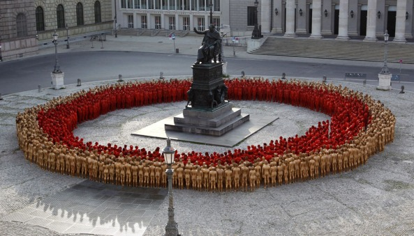 Naked volunteers, numbering around 1700 people, pose for U.S. artist Spencer Tunick in downtown Munich, on June 23, 2012. (Reuters/Michaela Rehle)