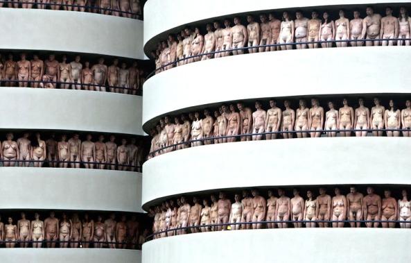 Naked volunteers pose for Spencer Tunick in the Europarking building in Amsterdam, on June 3, 2007. (Reuters/Koen van Weel)