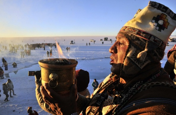 An Aymara priest participates in a ritual at sunrise to celebrate the Aymara New Year on June 21, 2013 at the Uyuni salt flat in Bolivia. A crowd gathered to receive the first rays of Tata Inti (god Sun) during the celebration of the winter solstice that marks the beginning of the 5521st year in the Aymara calendar. AFP/PHOTO/Aizar RALDESAIZAR RALDES/AFP/Getty Images ORG XMIT: