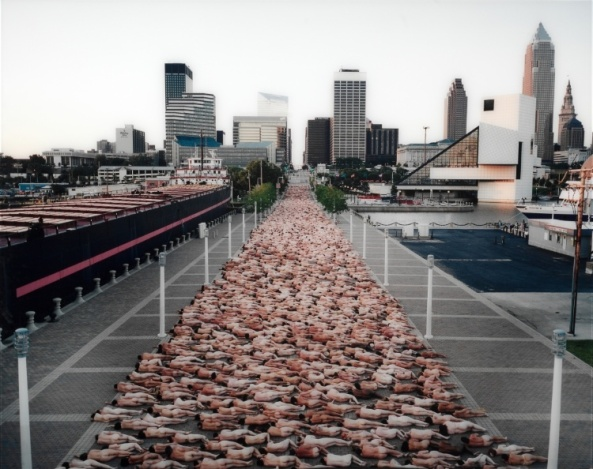 Since the early 1990s, Tunick has organized more than 75 temporary installations in public spaces worldwide. He deftly positions dozens, hundreds, or thousands of nude volunteers to define and expand his chosen locations, and then takes photographs. In Cleveland on June 26, 2004, Tunick created his largest North American installation to date. As part of an exhibition of his work at the Museum of Contemporary Art Cleveland (MOCA), Tunick positioned more than 2,700 people along East 9th Street. The figures rhythmically define this urban space while adding a sense of humanity. The project was a compelling union of sculpture, performance, and public art beautifully captured in this striking color image. The elongated, abstract mass of flesh challenges one's notion of nudity and privacy. Gift of Timothy and Nancy Callahan, Stewart and Donna Kohl, and Mark Schwartz and Bettina Katz 2004.69