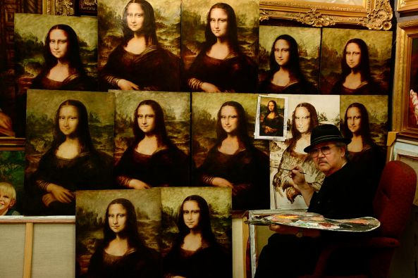 Painter works on copying Leonardo's masterpiece, surrounded by finished copies.