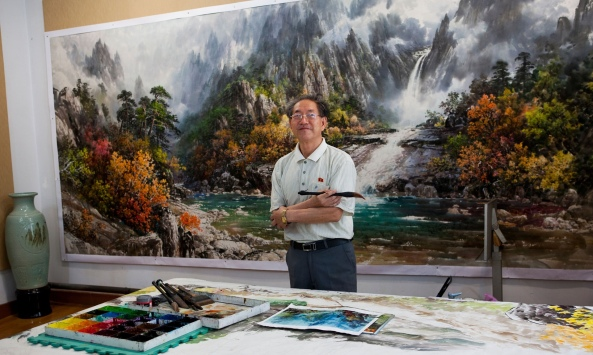 A state-artist in residence at the Mansudae Art Studio Photograph: Alamy