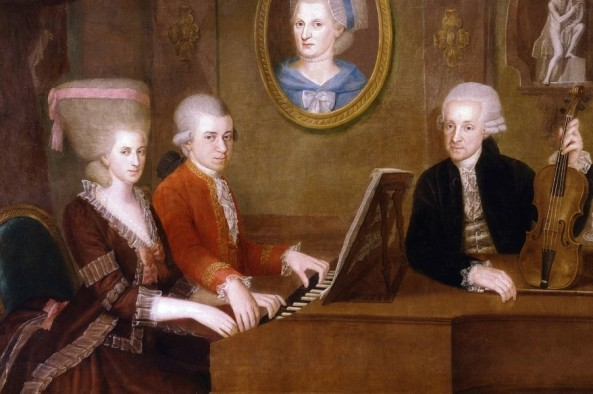 Leopold Mozart with his children Wolfgang and Nannerl at the piano, the portrait of their deceased mother on the wall. Oil on Canvas by Johann Nepomuk Della Croce, around 1780.