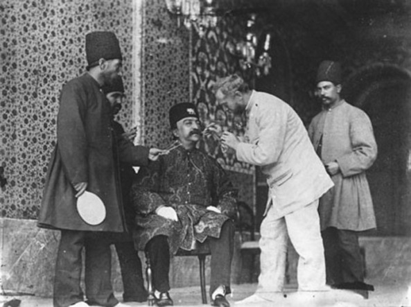 Anton Sevryugin sets up a photo-shoot with the Shah.