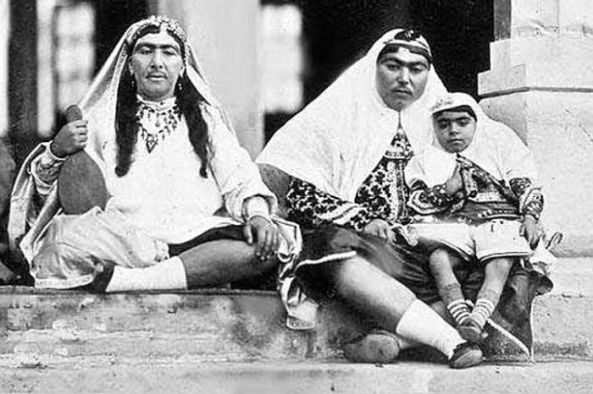 Anis is the one with a child on her lap with another woman of the Shah's harem.
