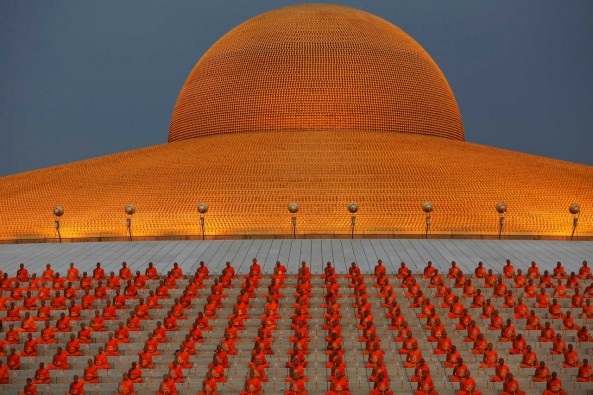 Buddhist monks pray at the Wat Phra Dhammakaya temple in Pathum Thani province, north of Bangkok on Makha Bucha Day