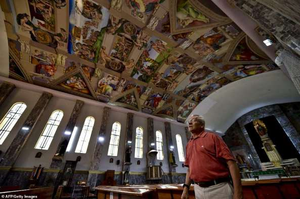 1. Miguel Francisco Macias gazes up at his replica Sistine Chapel frescoes in Mexico City